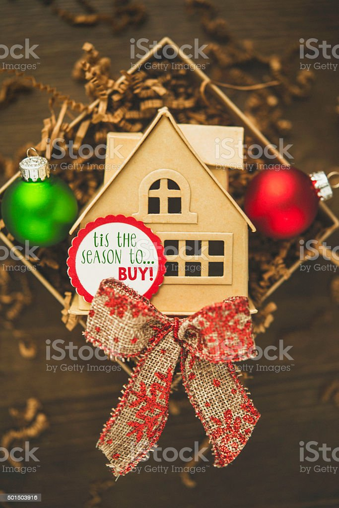 House gift with Christmas decorations. Tis the season to buy stock photo