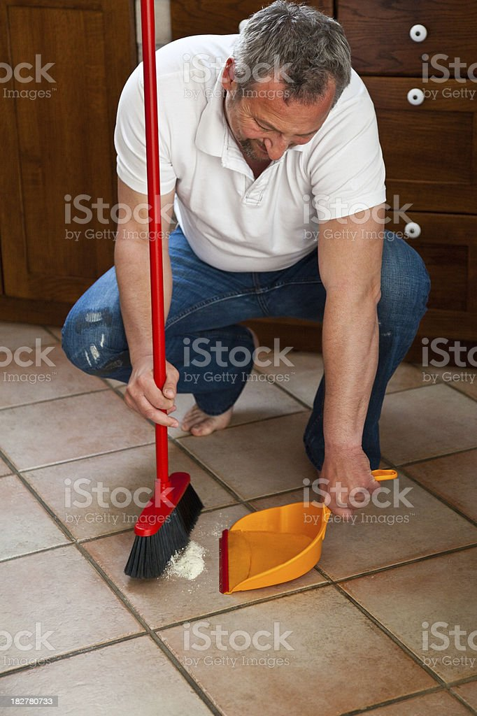 House Husband with Broom and Dustpan. stock photo
