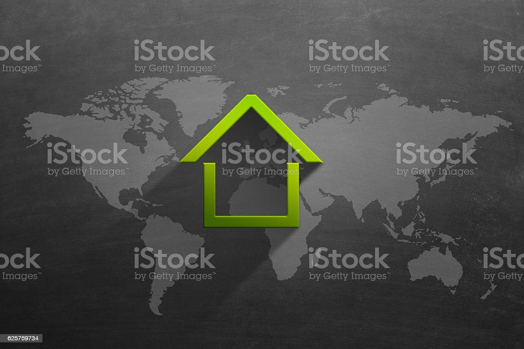 House icon in front of map on blackboard stock photo