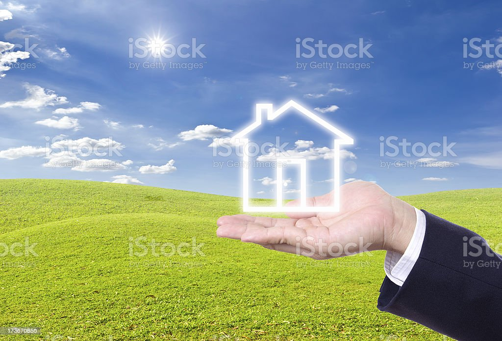 house icon on hand royalty-free stock photo