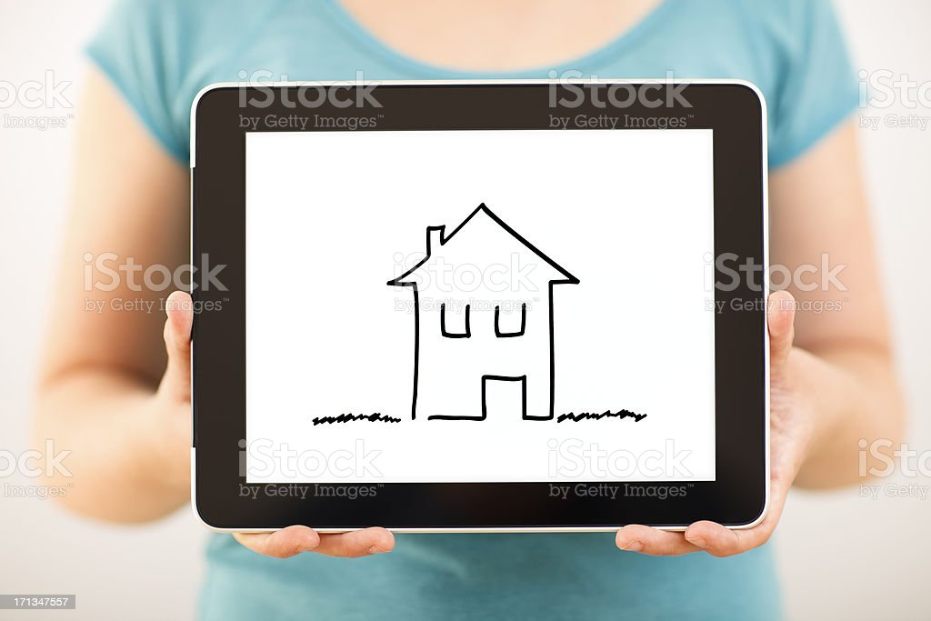 House in a digital tablet royalty-free stock photo