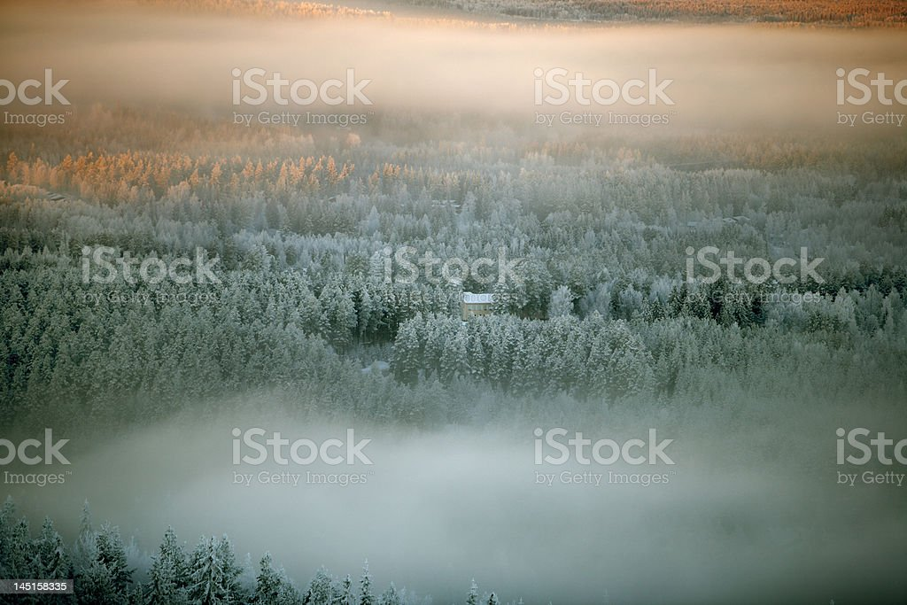 house in a winter forest royalty-free stock photo