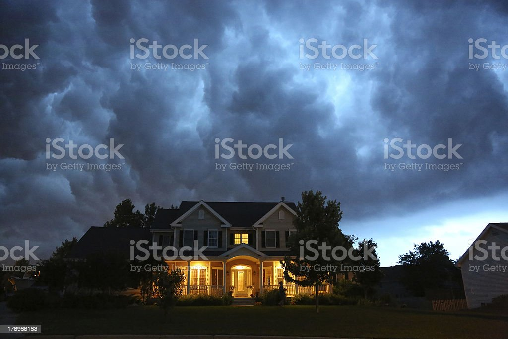 House in bad summer thunderstorm stock photo