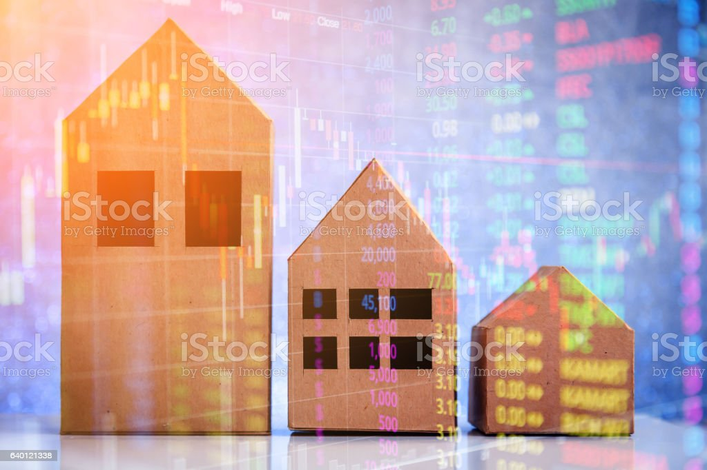 house in brown recycled paper on white floor stock photo