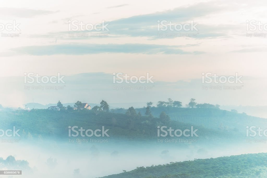 House in foggy mountains at dawn stock photo