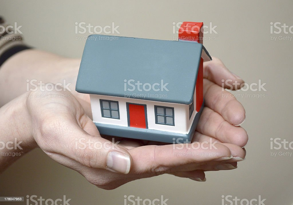 house in hands - caring for you royalty-free stock photo