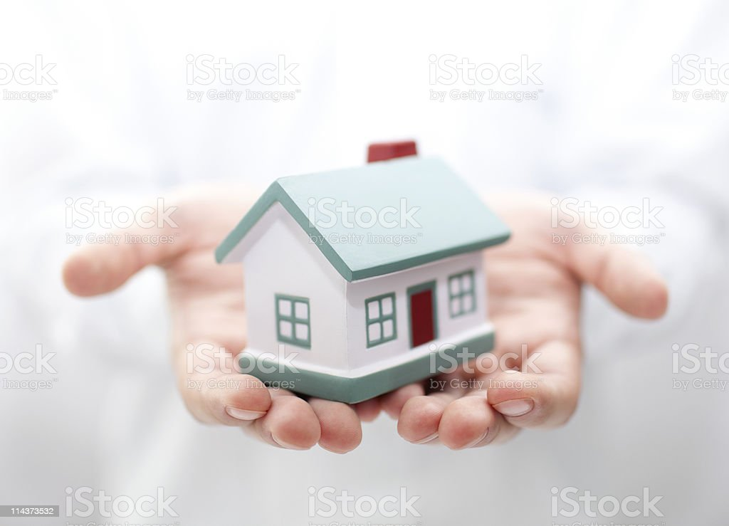 House in hands. Shallow DOF stock photo