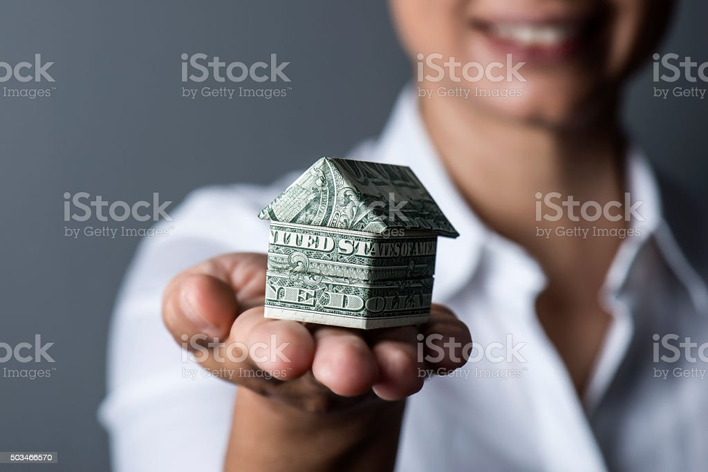 House in Human Hand stock photo