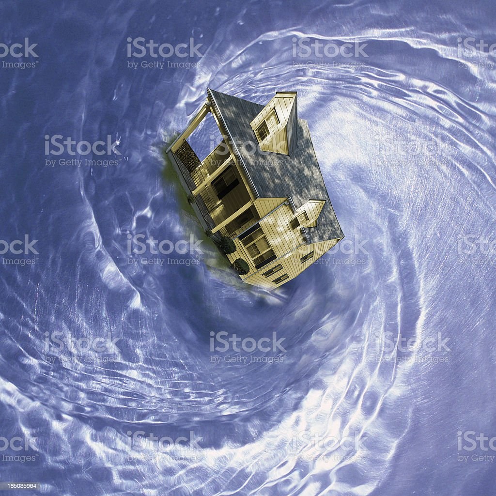 house in spinning whirlpool stock photo