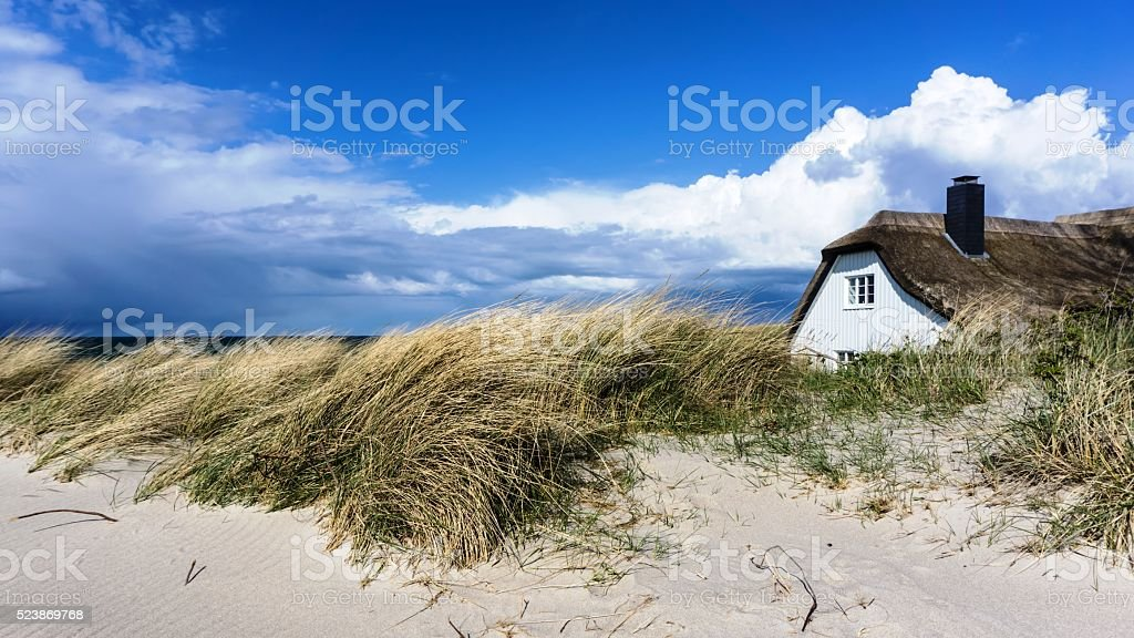 house in the dune stock photo