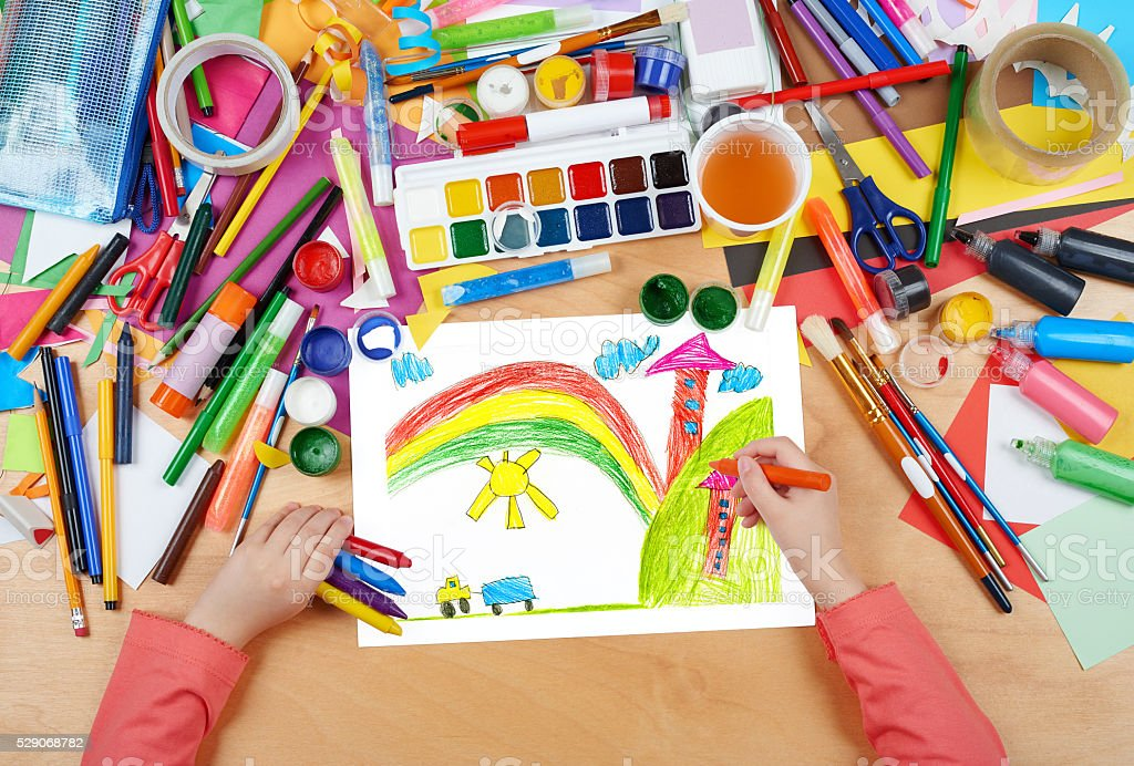 house in village child drawing, top view hands stock photo