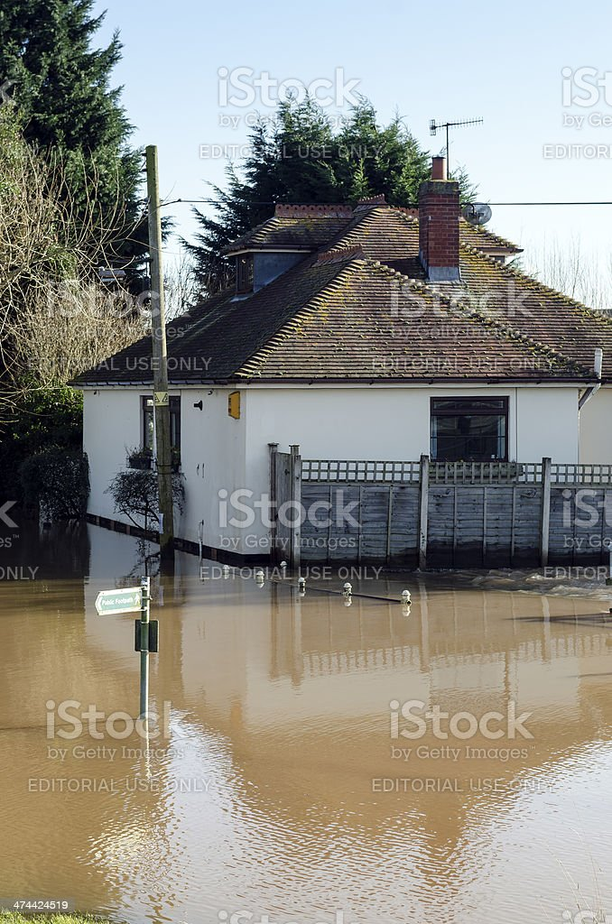 House inundated with flood water royalty-free stock photo