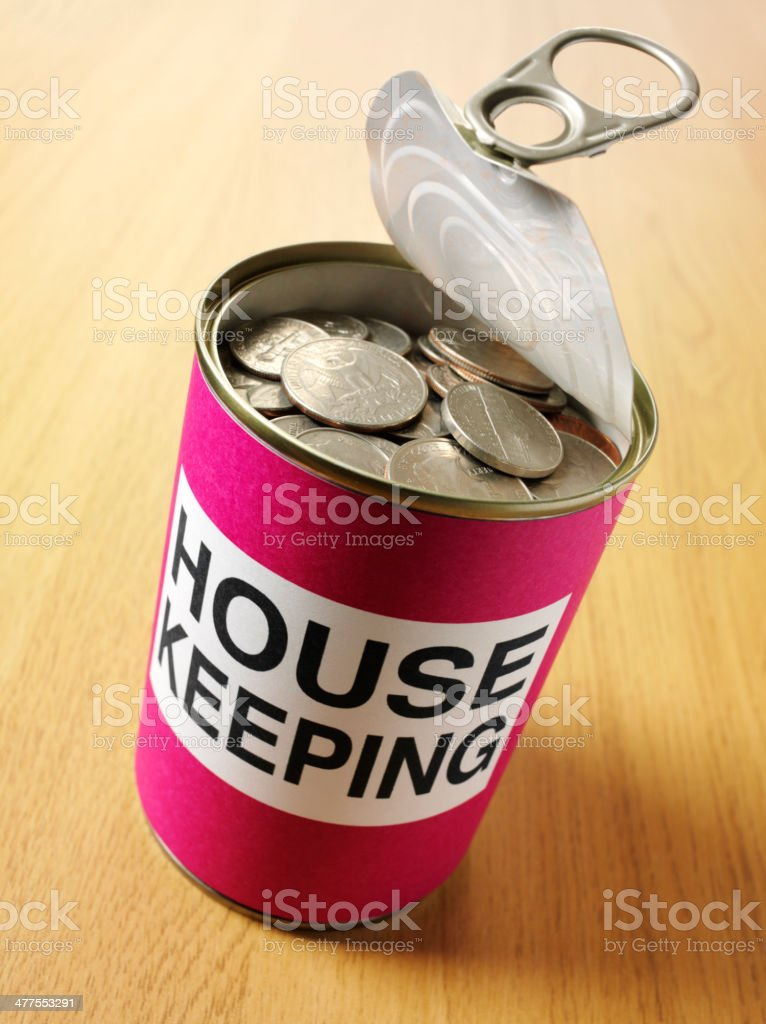 House Keeping Label on a Tin Can with American Currency royalty-free stock photo