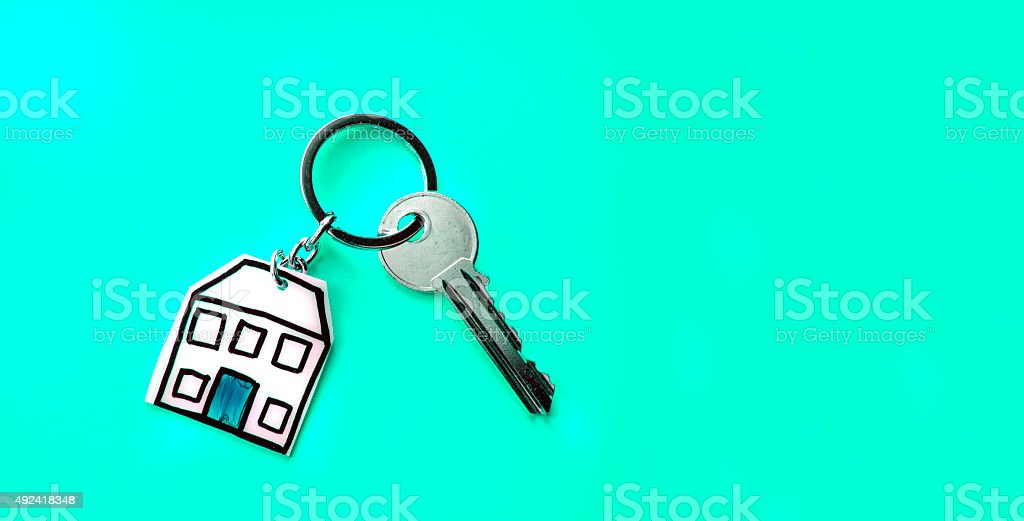 House key and keyring with copy space stock photo