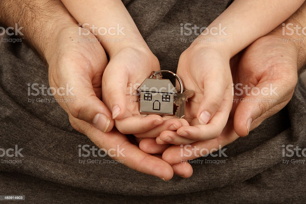 House Key in Family hands stock photo
