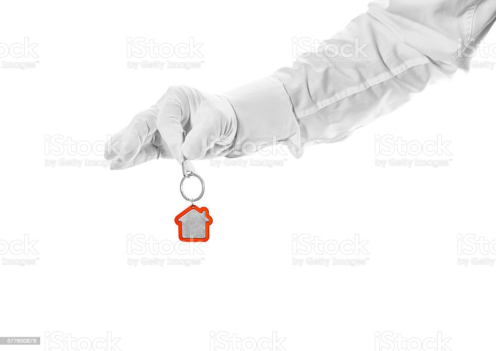 House key in hand butler stock photo