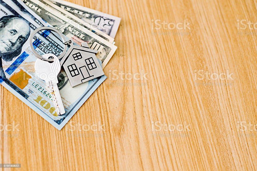 House key on cash stock photo