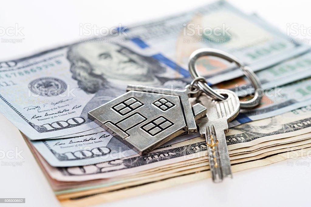 House key on money stock photo