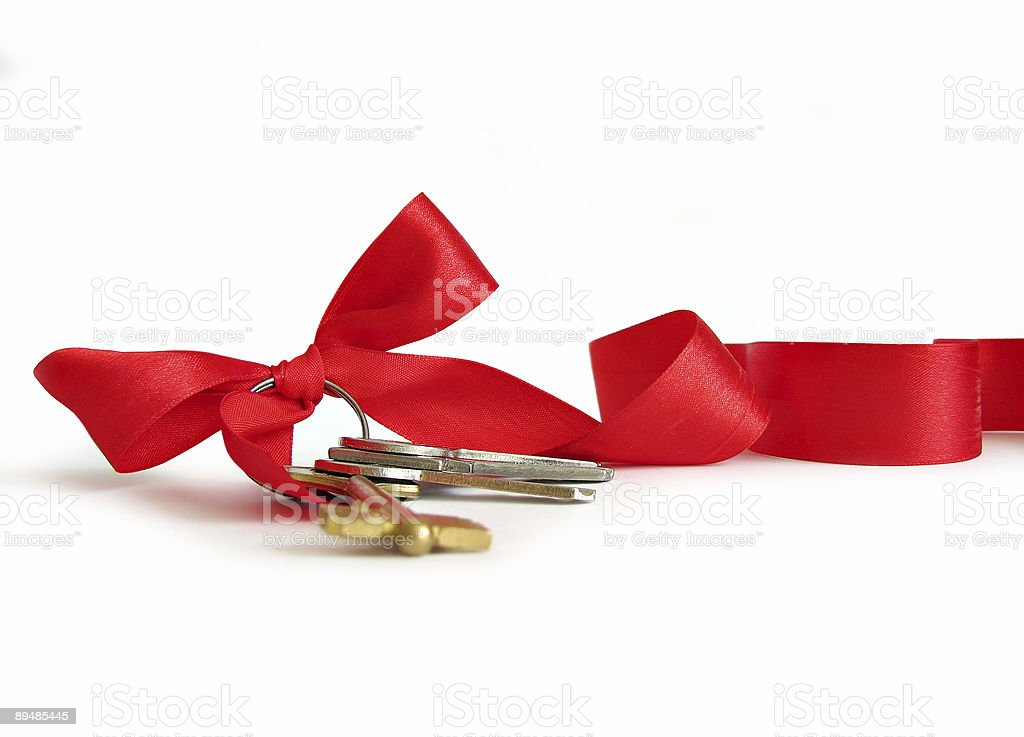 House keys decorated by red ribbon stock photo