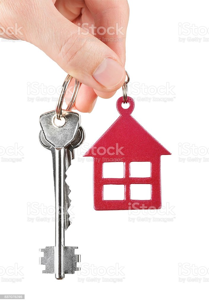 House keys in hand isolated on white background stock photo