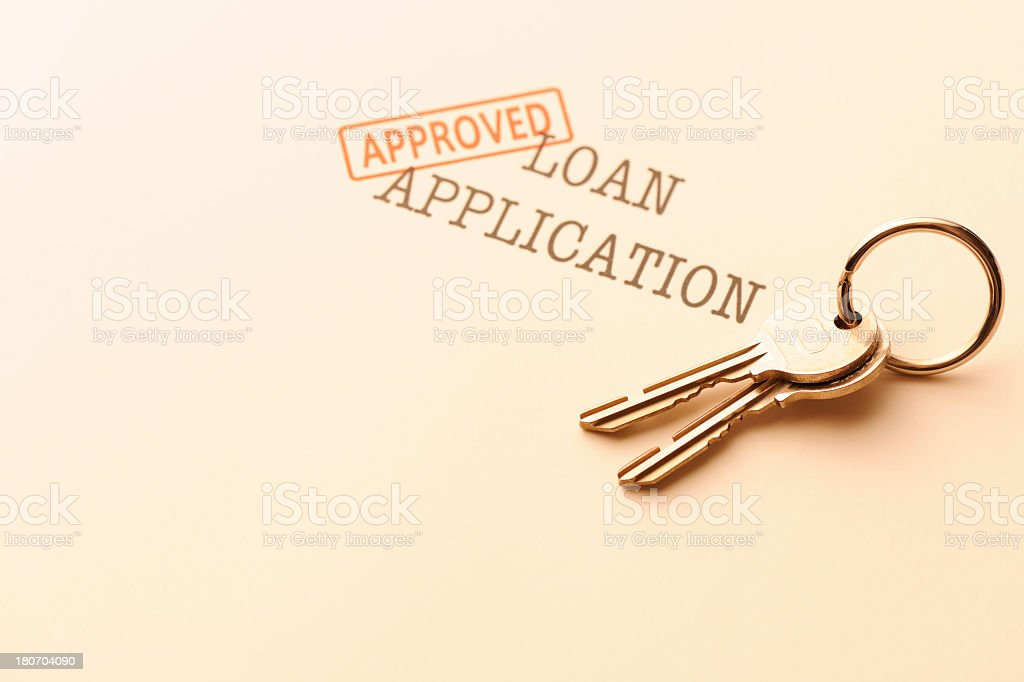 House keys on approved application form with copy space royalty-free stock photo