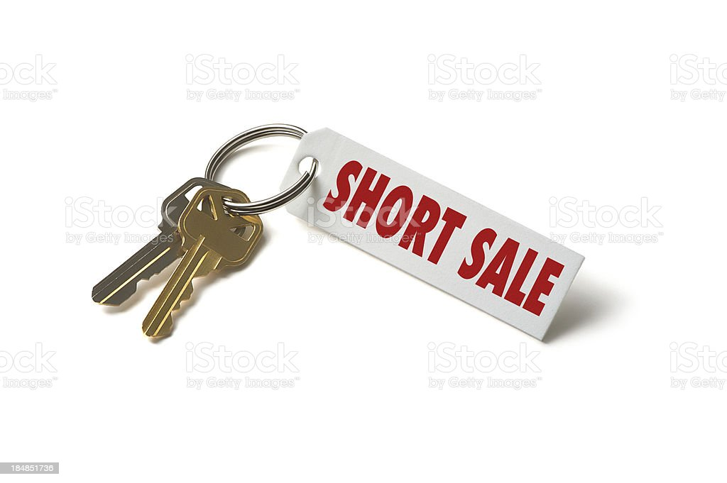 House Keys with Short Sale Tag Isolated on White Background royalty-free stock photo