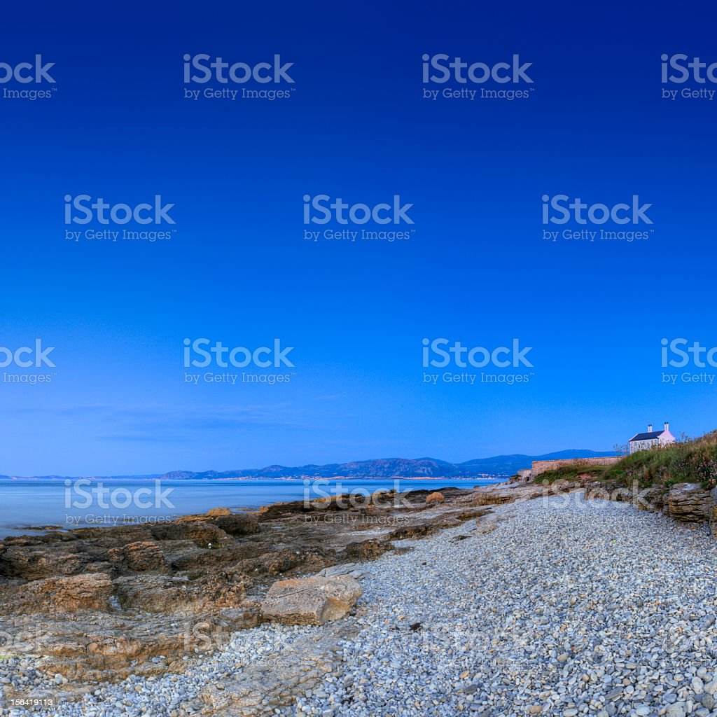 House looking over sea, Angelsey royalty-free stock photo