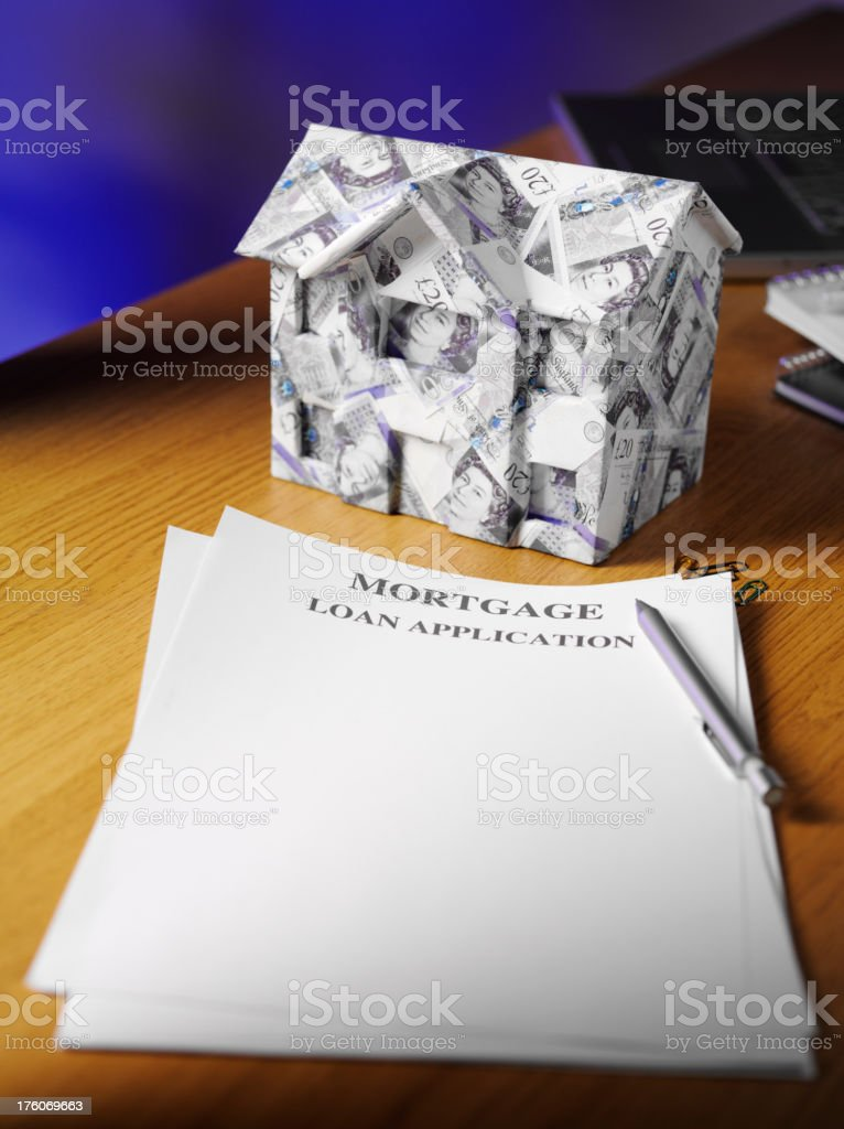 House made of British Pounds with documents in a Office stock photo