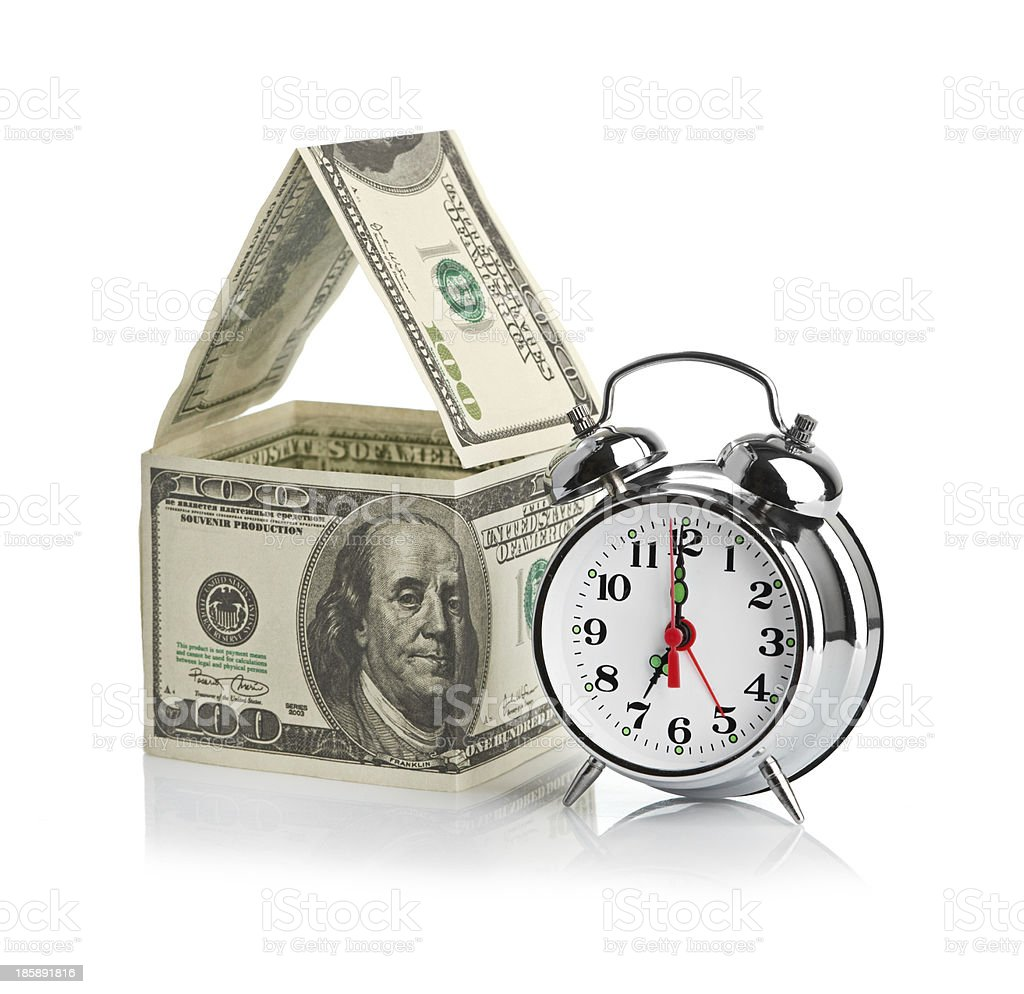 house made of dollars and alarm clock. royalty-free stock photo