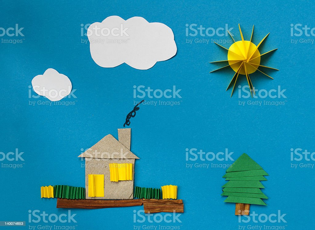House made ​​of paper over blue royalty-free stock photo