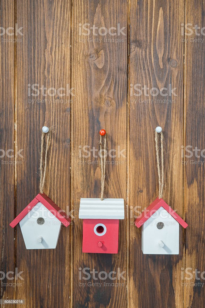 house model hanging on wooden background stock photo