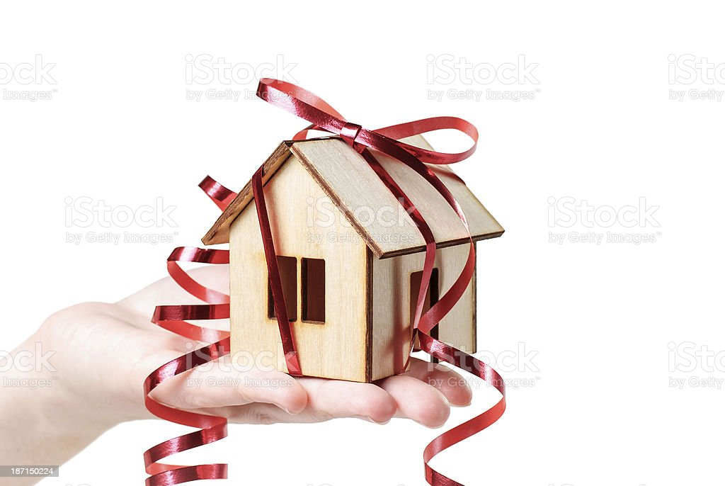 House model with ribbon on  hand royalty-free stock photo