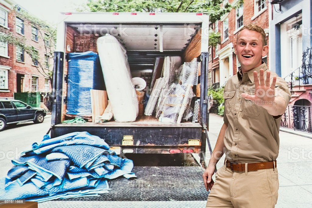 House mover showing stop hand sign stock photo