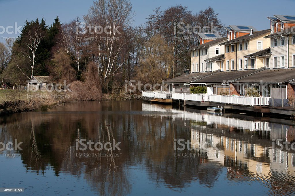 House near water in quiet neighborhood stock photo