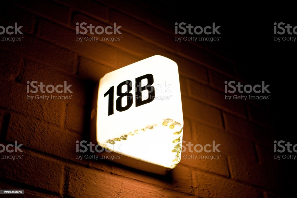 House number 18B at Night stock photo