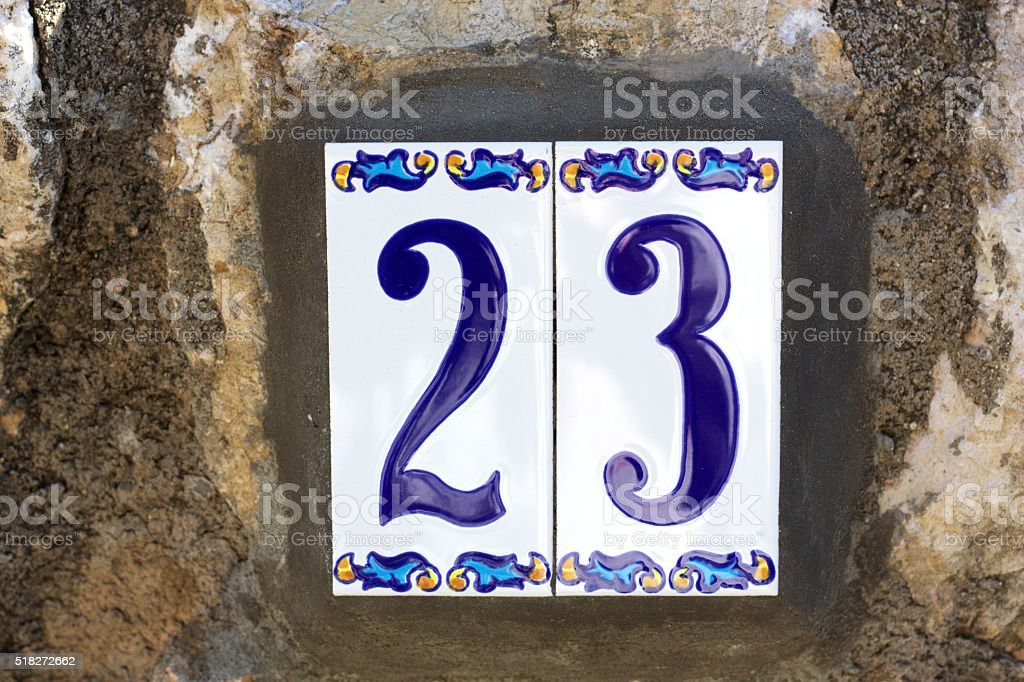 House number 23, made in ceramic and hand painted stock photo