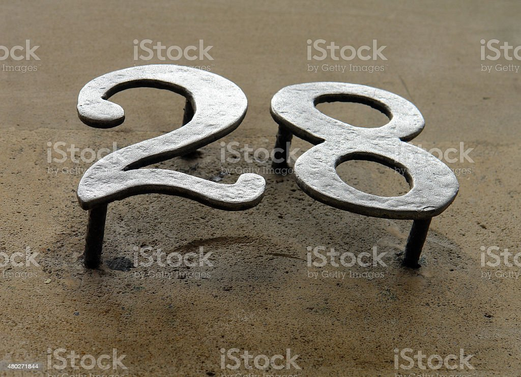 house number on the wall stock photo