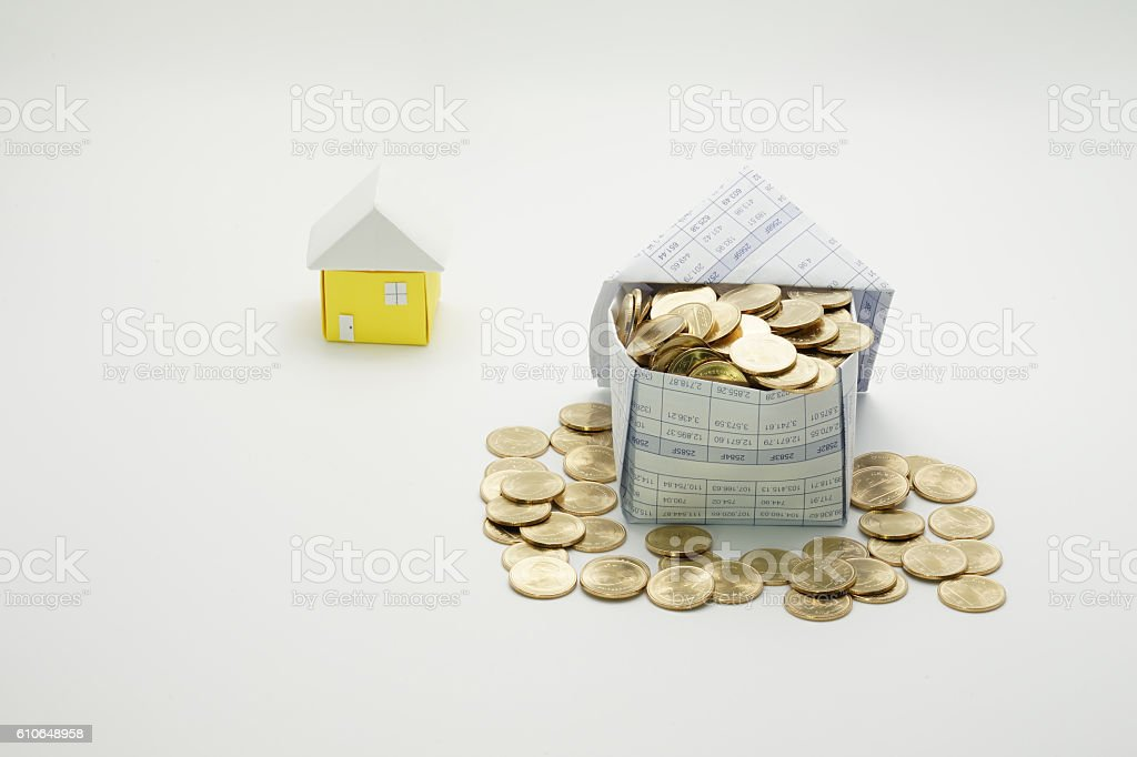 House of gold coins and little house royalty-free stock photo