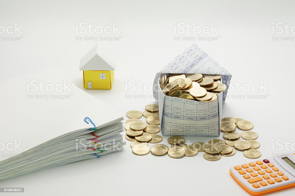 House of gold coins and pile overload document of report royalty-free stock photo