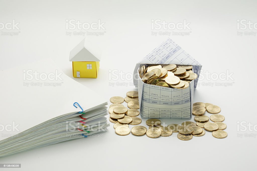 House of gold coins and pile overload document royalty-free stock photo