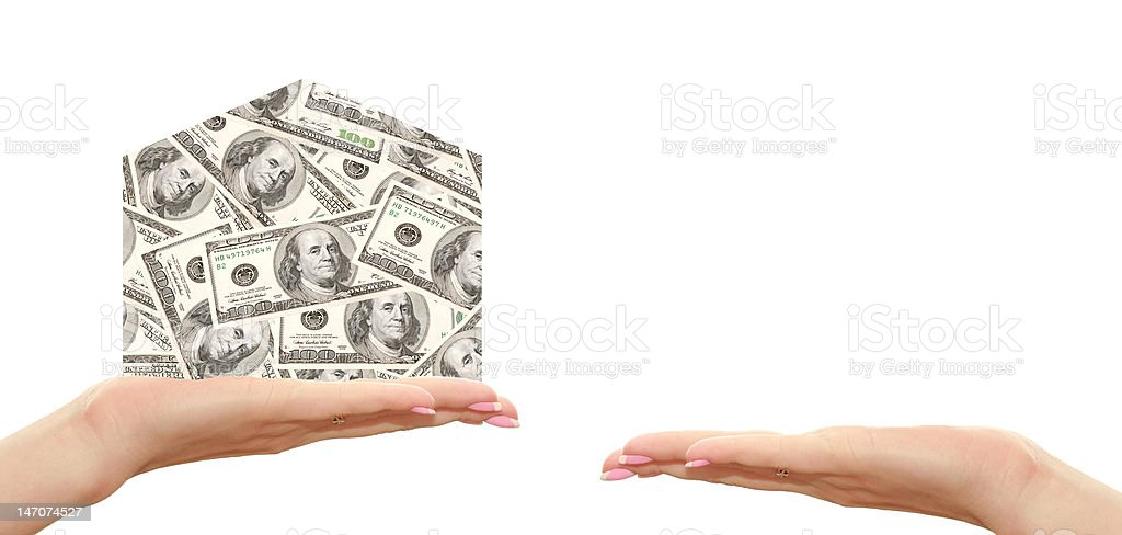 house of hundred dollars on hand royalty-free stock photo