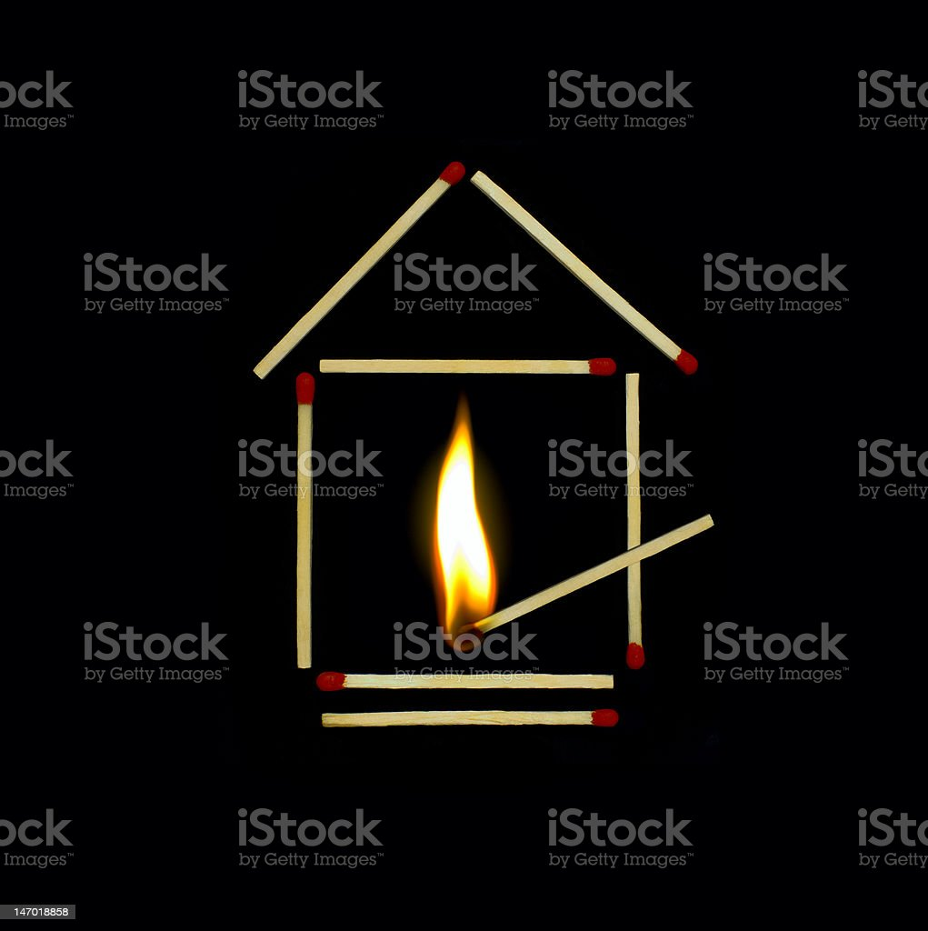 house of matches on fire royalty-free stock photo