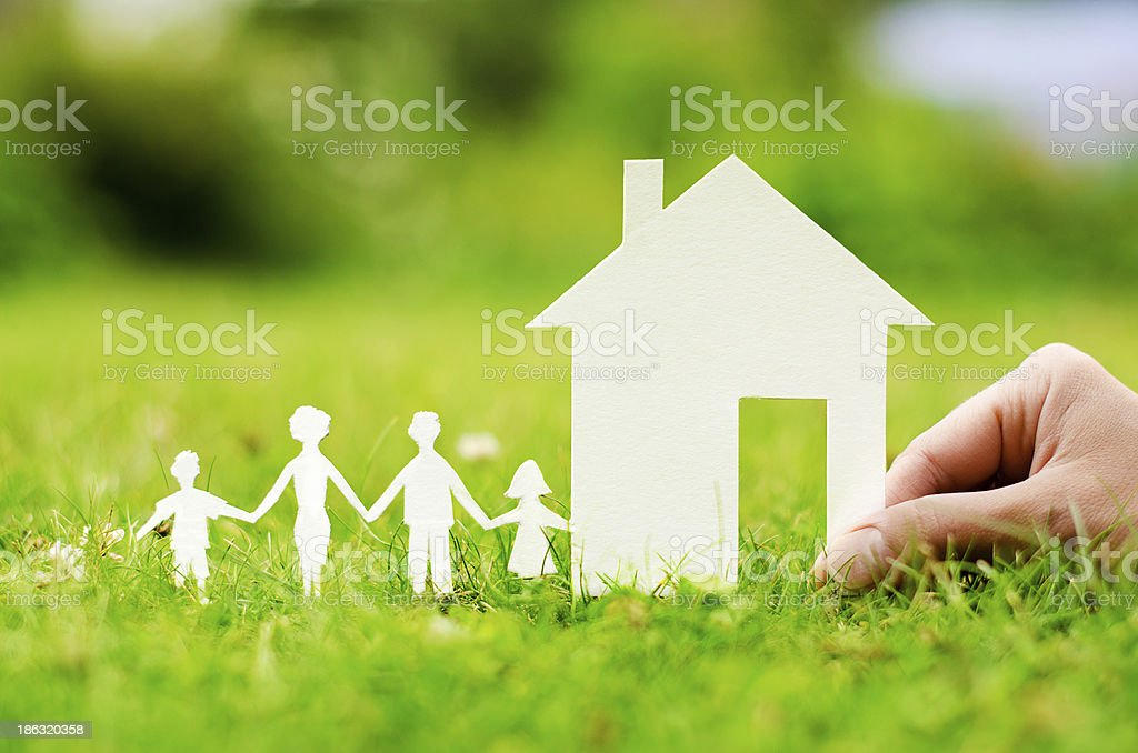 House of paper in hand stock photo