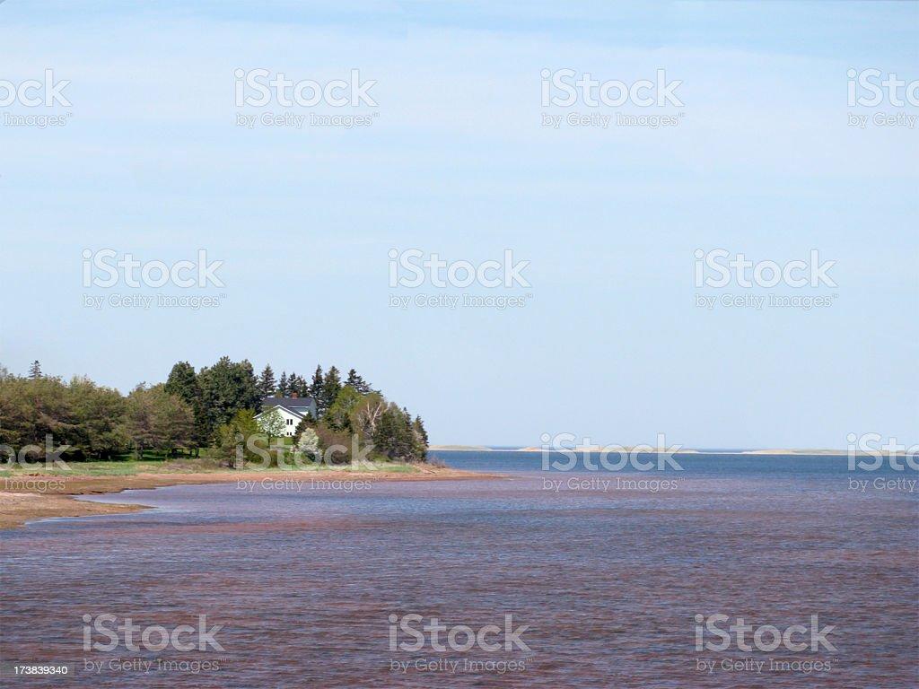 House on a headland, Prince Edward Island. stock photo
