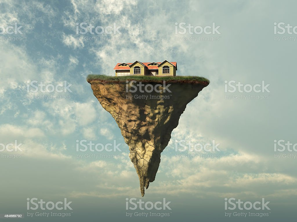 House on a piece of land floating in the sky stock photo
