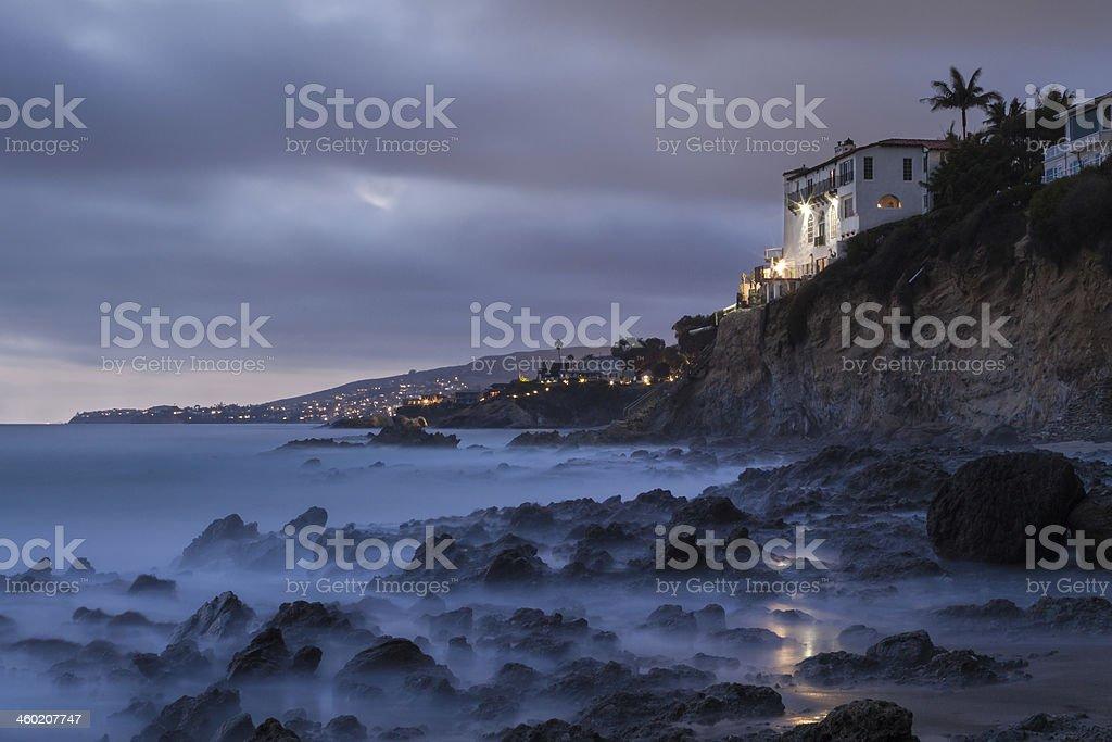 House on cliff overlooking the rocky coast stock photo