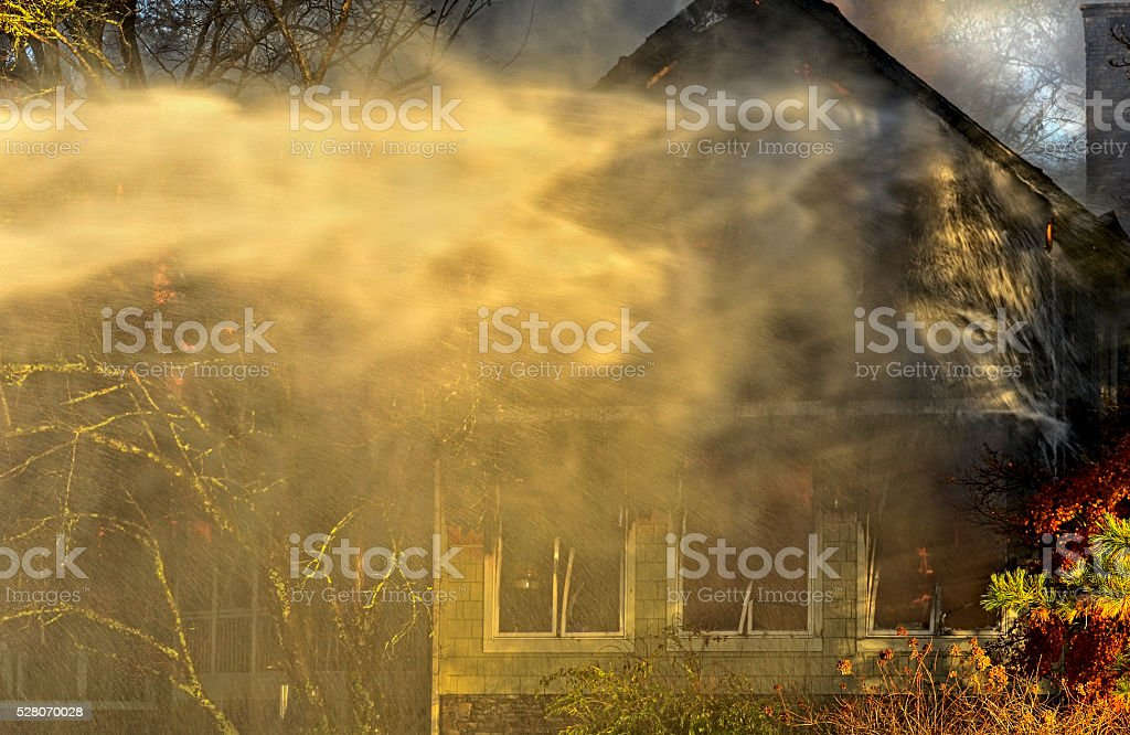 House on Fire in Evening stock photo