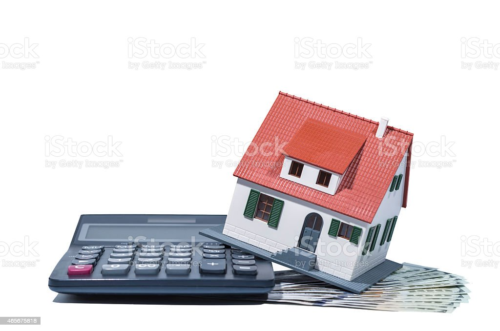 House on money and calculator(Clipping path included) stock photo