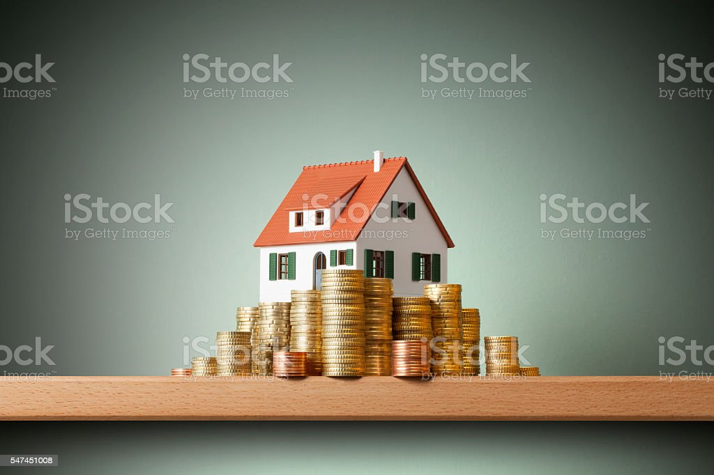 House on money stack stock photo