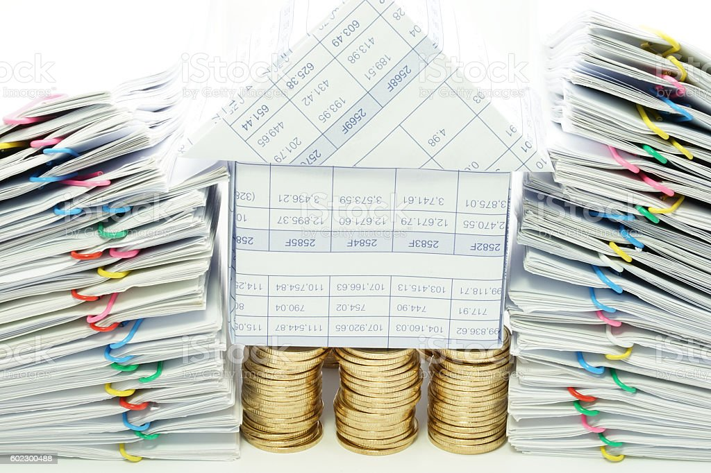 House on pile of gold coins between dual pile overload royalty-free stock photo